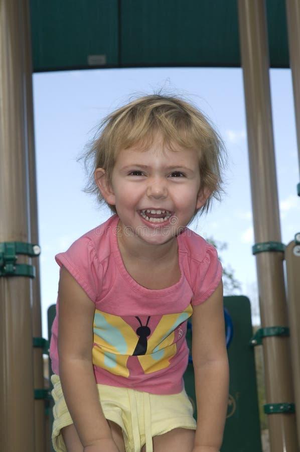Petit enfant riant photographie stock
