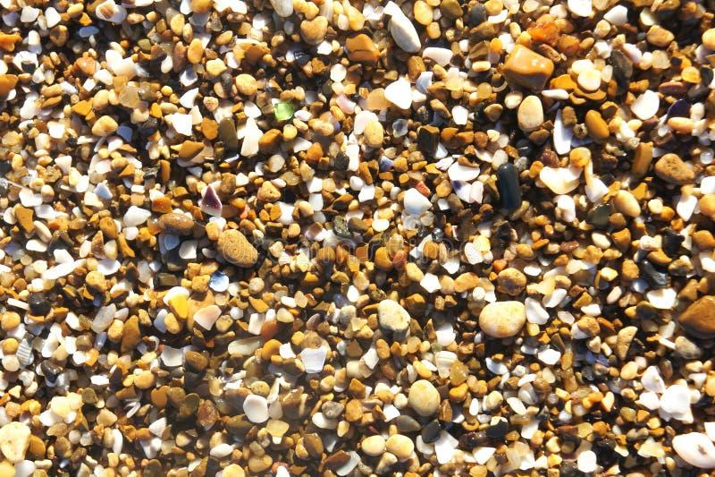Petit fond de sable de caillou de mer photo libre de droits