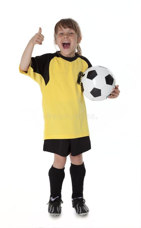 Petit footballeur mignon photo stock