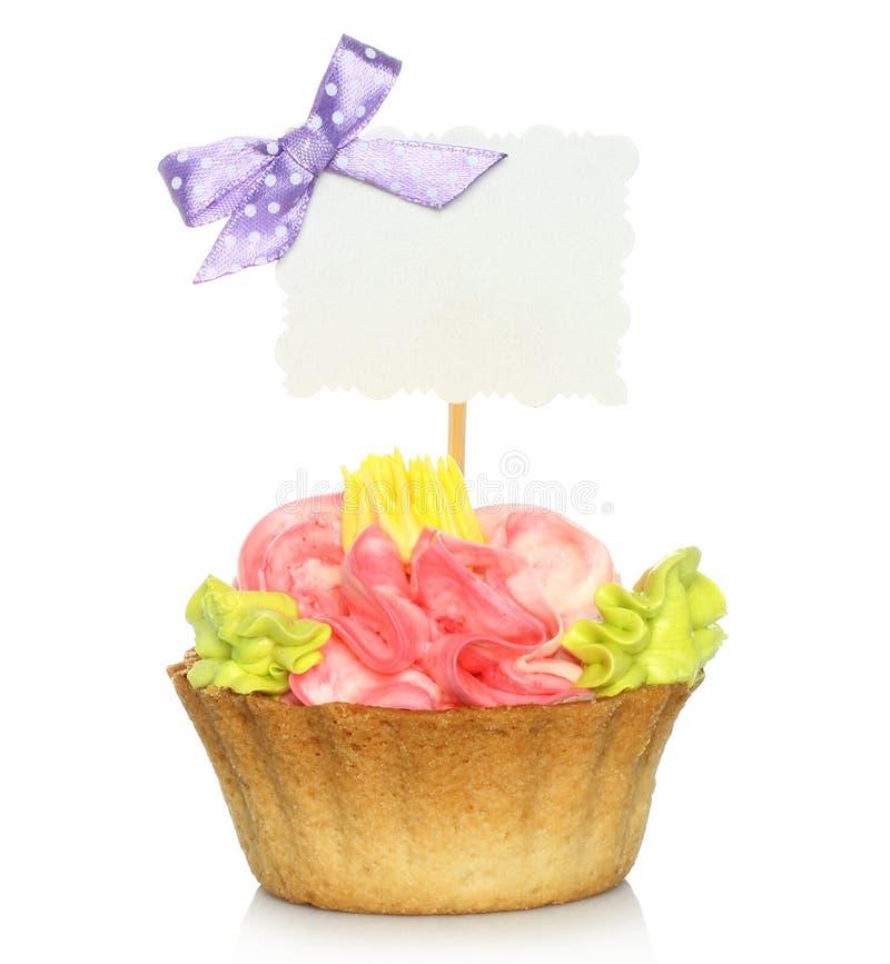 Petit gâteau avec la carte vierge photographie stock
