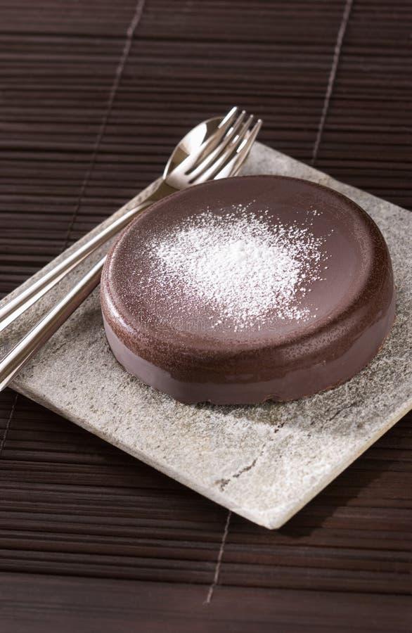 Petit gâteau de chocolat images libres de droits
