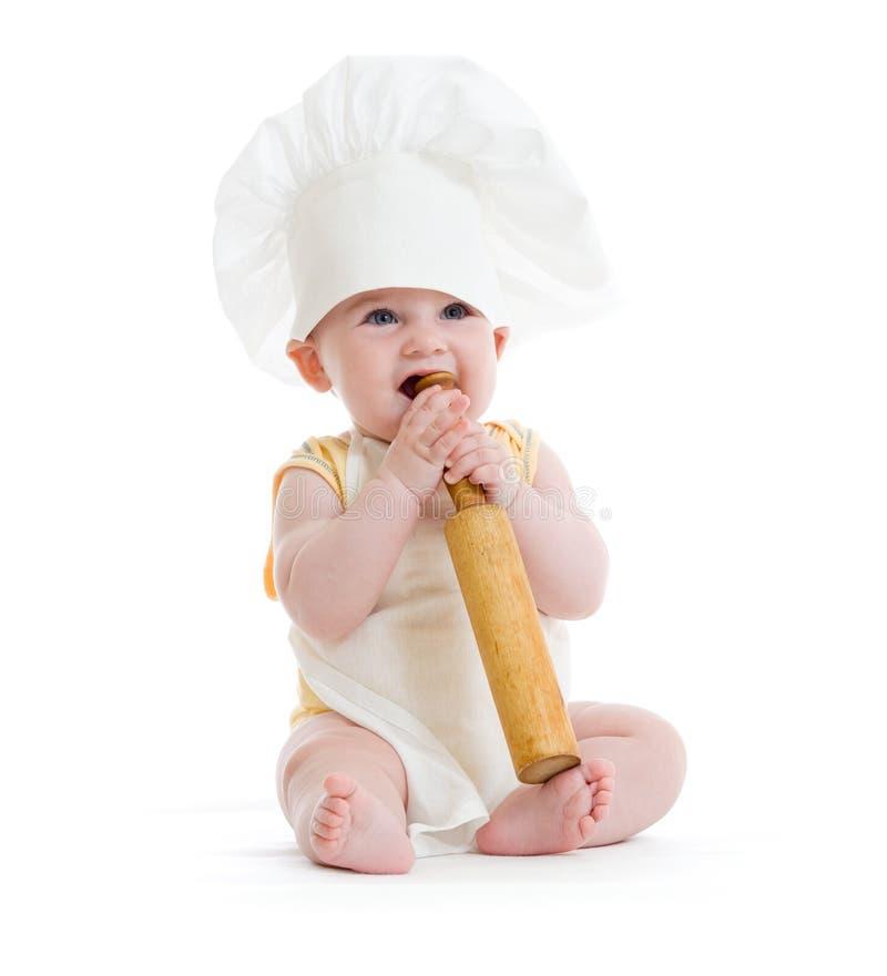 Petit garçon avec la goupille et le chapeau de cuisinier d'isolement photo stock