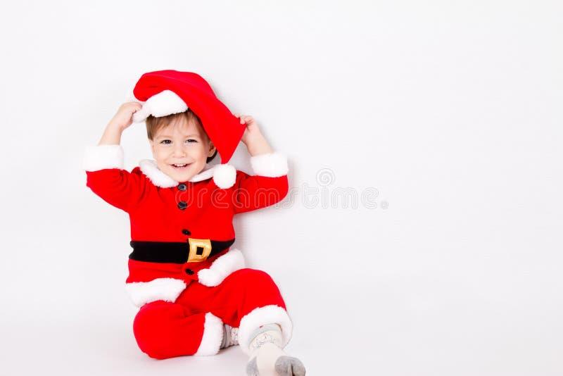 Petit garçon avec le costume de Santa images stock
