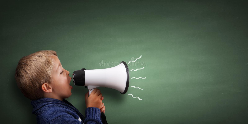 Petit garçon avec le mégaphone image libre de droits