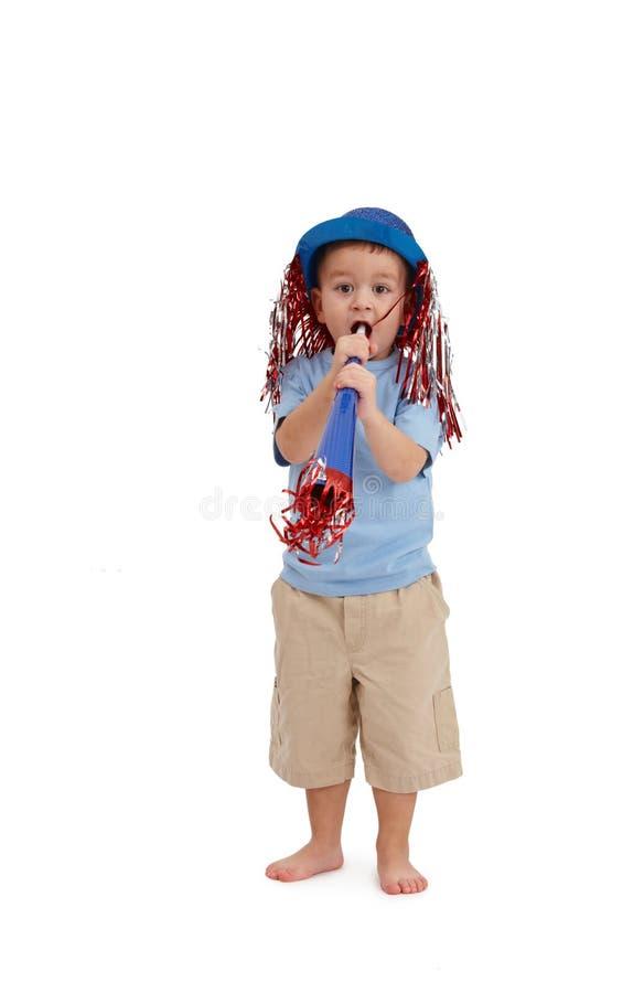 Petit garçon ayant l'amusement de partie photos stock