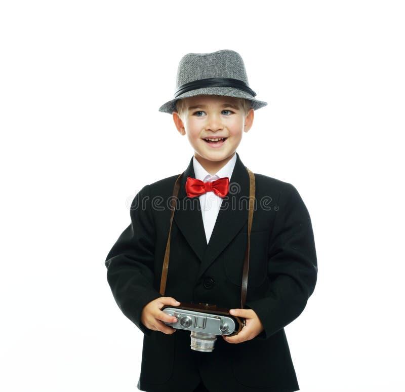 Petit garçon dans le chapeau et le costume noir photos libres de droits