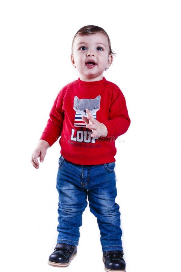 Petit garçon heureux un an sur un fond blanc photo stock
