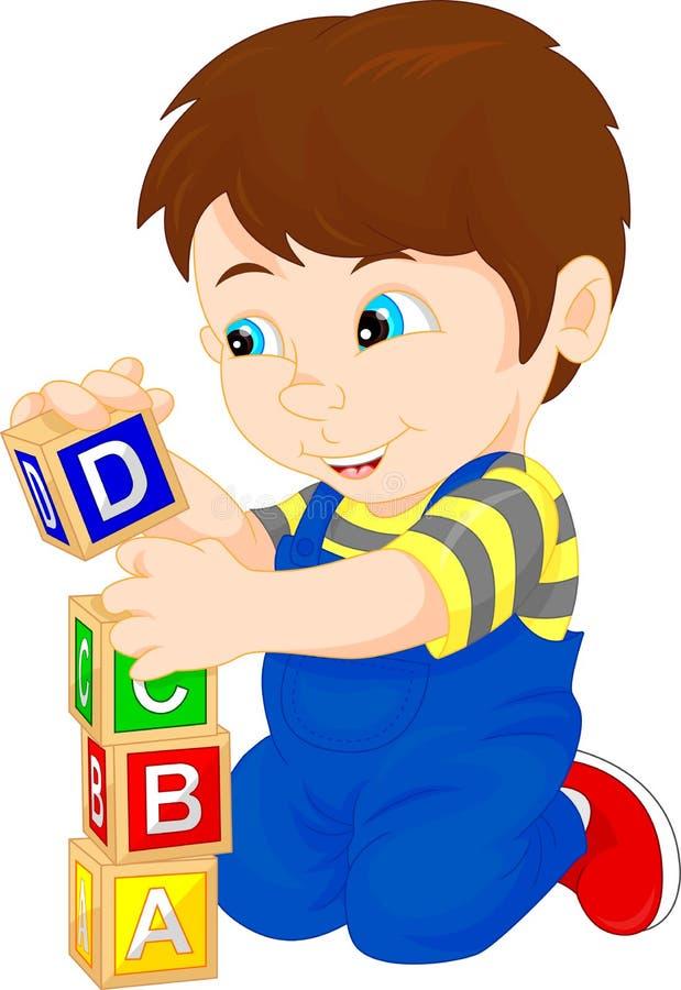 Petit garçon jouant avec le bloc d'alphabet illustration libre de droits