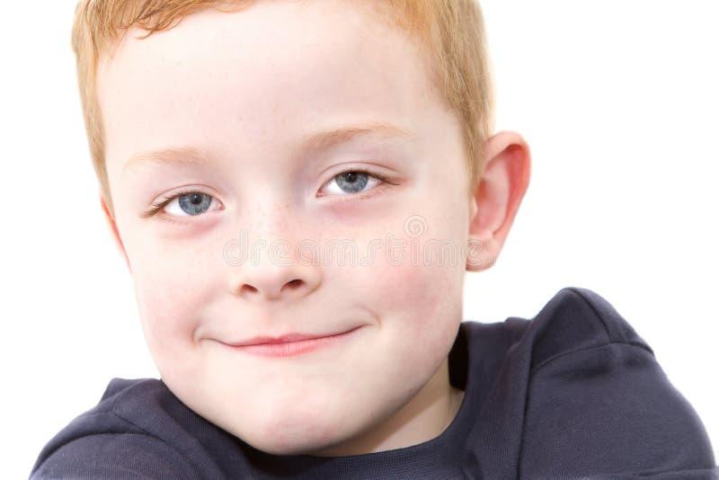 Petit garçon satisfait photos stock