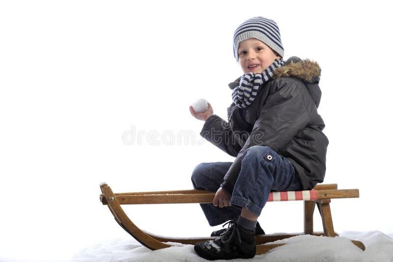 Petit garçon sur l'étrier photographie stock