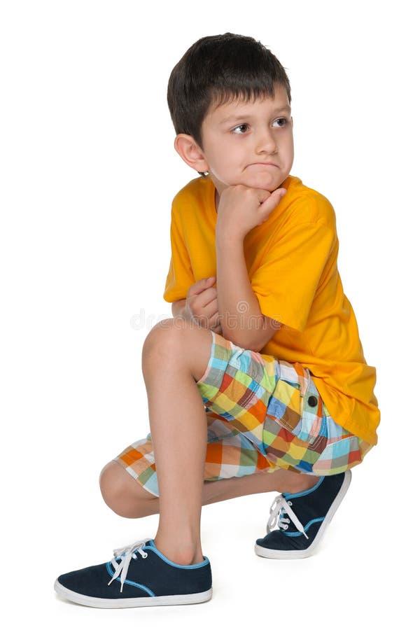 Petit garçon très réfléchi images libres de droits