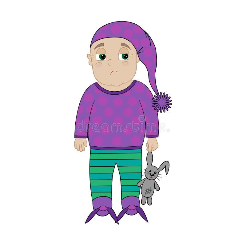 Petit garçon triste mignon dans des pyjamas colorés photo libre de droits
