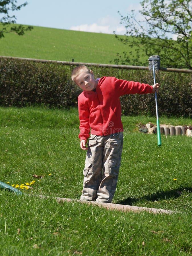 Petit golfeur photos stock