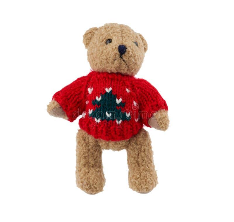 petit joli ours en peluche brun avec un pull tricoté rouge images stock