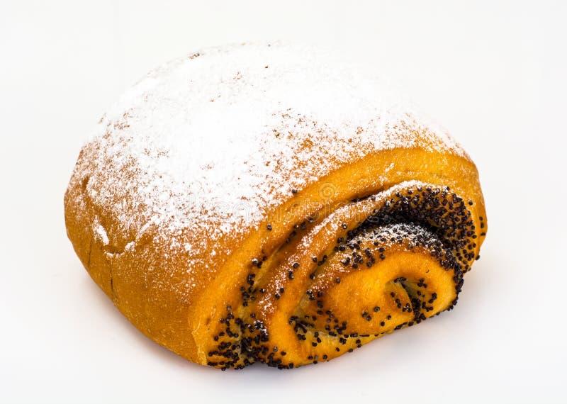 Petit pain avec Poppy Seeds et arroser le sucre en poudre images libres de droits