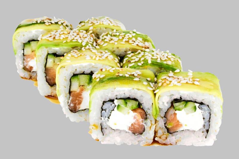 Petit pain de sushi d'avocat avec de la sauce à Unagi de concombre de fromage de saumons et de sésame photographie stock libre de droits