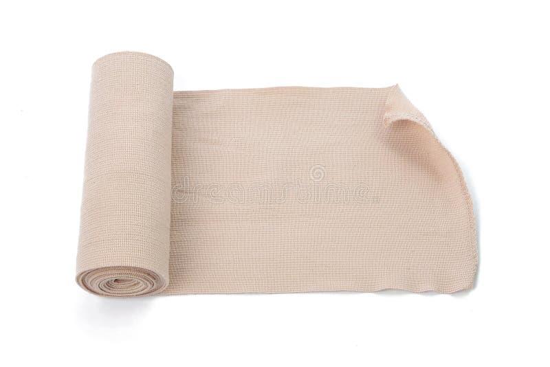 Petit pain médical de bandage d'isolement sur le fond blanc images stock