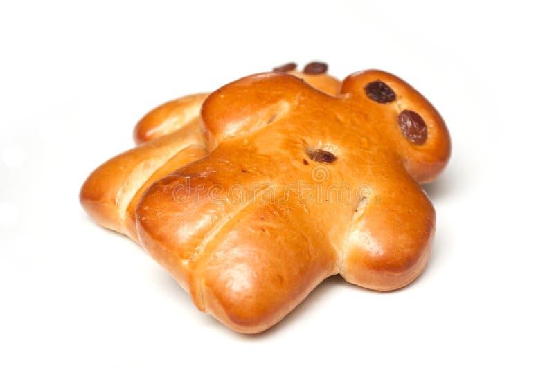 Petit pain traditionnel de manalas avec le raisin sec sec sur le fond blanc images libres de droits