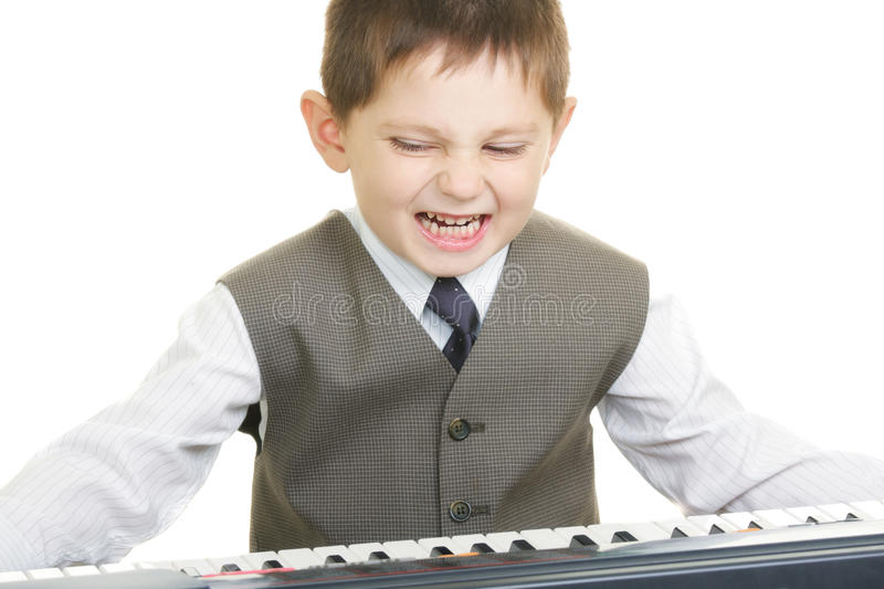 Petit pianiste expressif photo stock