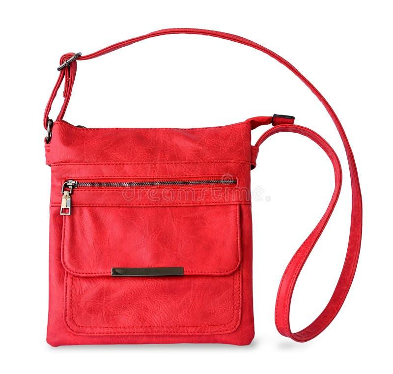 Petit sac à main occasionnel rouge avec une longue poignée et une attache de fermeture éclair Accessoires modernes à la mode fait photographie stock libre de droits
