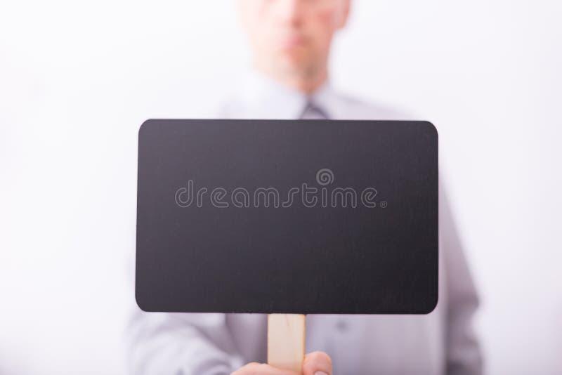 Petit tableau noir de prise masculine de main images libres de droits