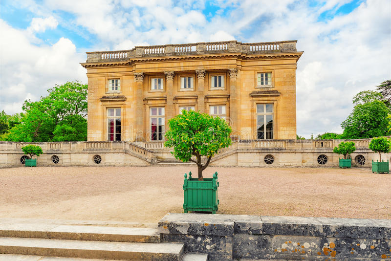 Petit Trianon-beautiful palace in a Famous Palace of Versailles. VERSAILLES, FRANCE - JULY 02, 2016 : Petit Trianon-beautiful palace in a Famous Palace of stock images
