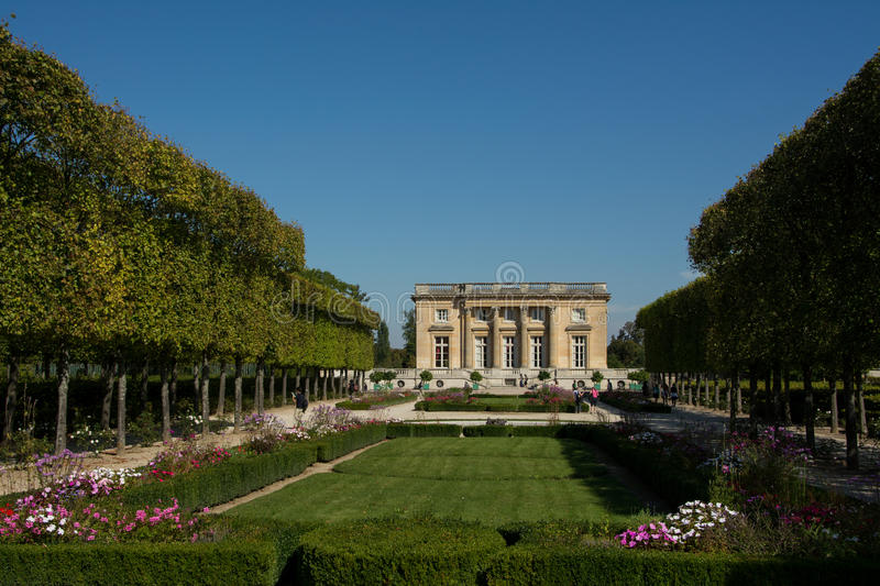 Petit Trianon. Chateau of Marie Antoinette Petit Trianon and its garden on the grounds of Palace of Versailles, France royalty free stock image