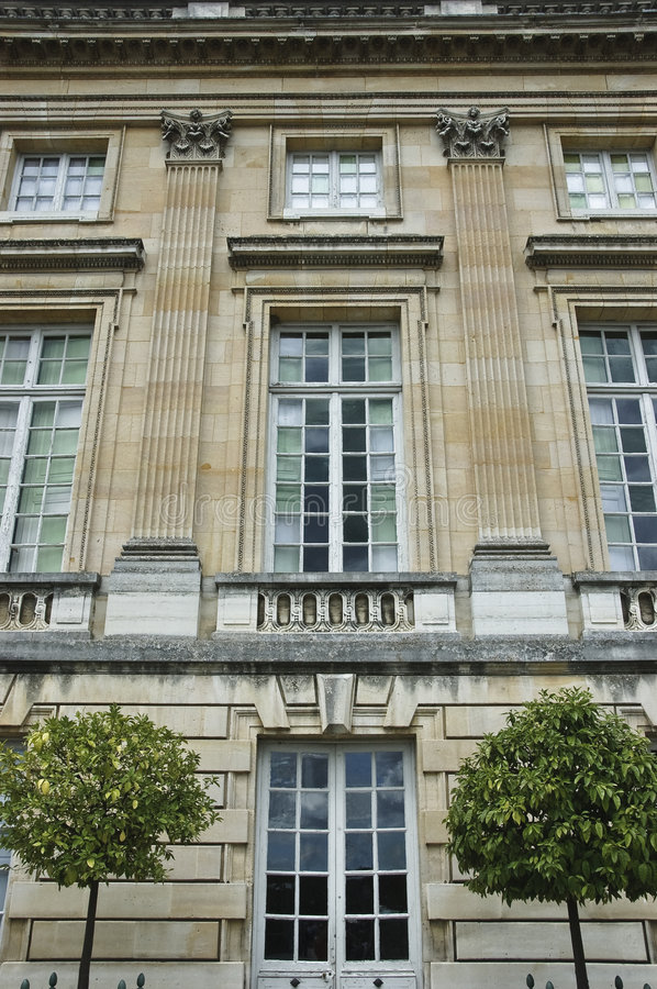 Petit Trianon at the Palace of Versailles. Detail of facade, Petit Trianon chateau, Marie-Antoinette's favorite retreat royalty free stock image