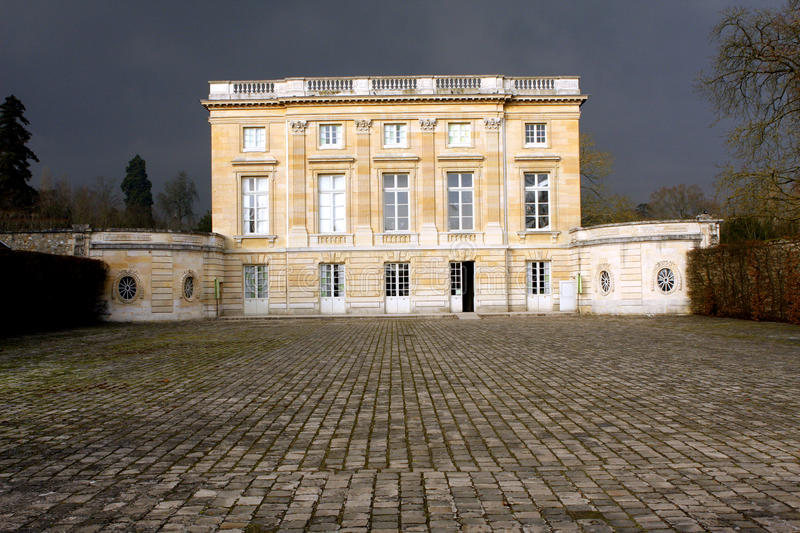 The Petit Trianon - Versailles. Petit Trianon, built between 1762 and 1768 during the reign of Louis XV, is a small château located on the grounds of the royalty free stock image