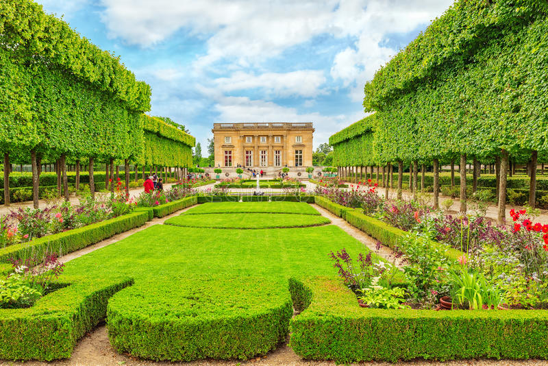 Petit Trianon. VERSAILLES, FRANCE - JULY 02, 2016 : Petit Trianon-beautiful Garden in a Famous Palace of Versailles Chateau de Versailles, France stock image