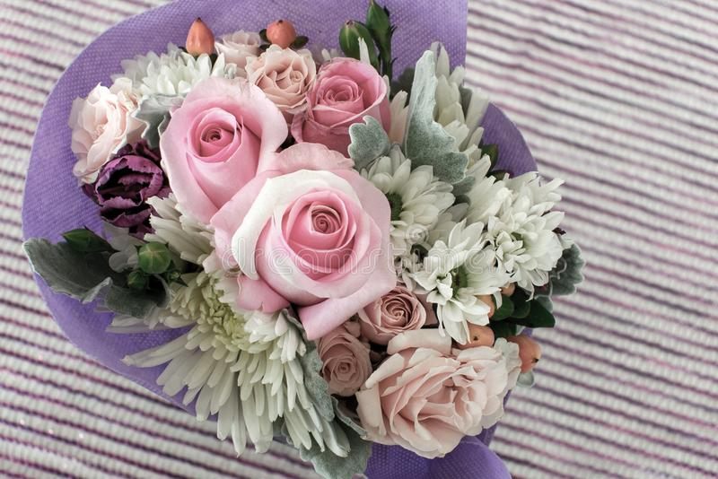 Bouquet of miniature roses on striped background royalty free stock photography