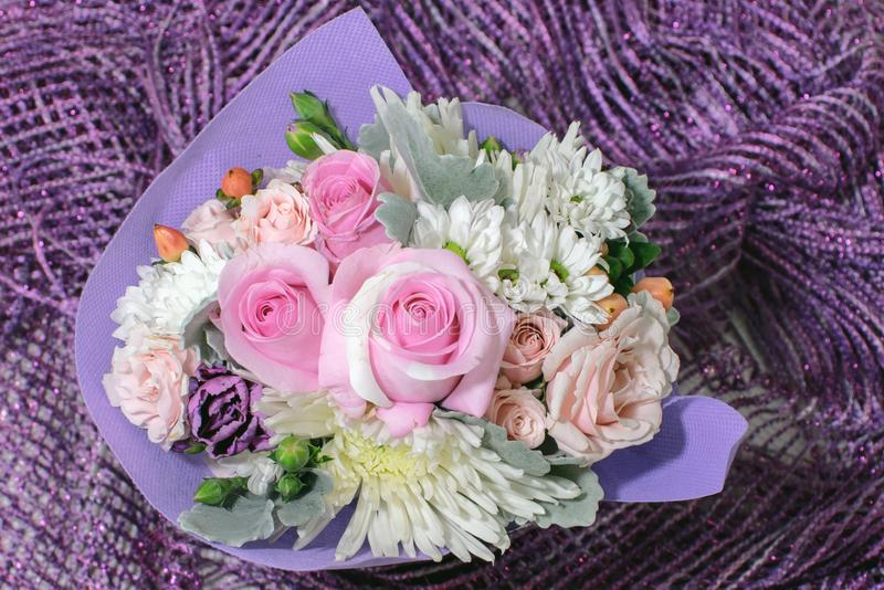 Pretty small bouquet with pink roses and other small flowers royalty free stock photo