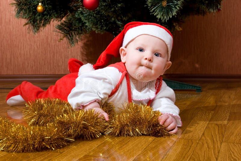 Petite chéri Santa avec des cadeaux photos stock