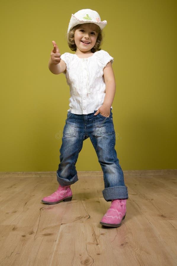 Petite cow-girl drôle photographie stock libre de droits