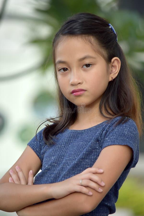 Petite femelle adolescente asiatique têtue image libre de droits