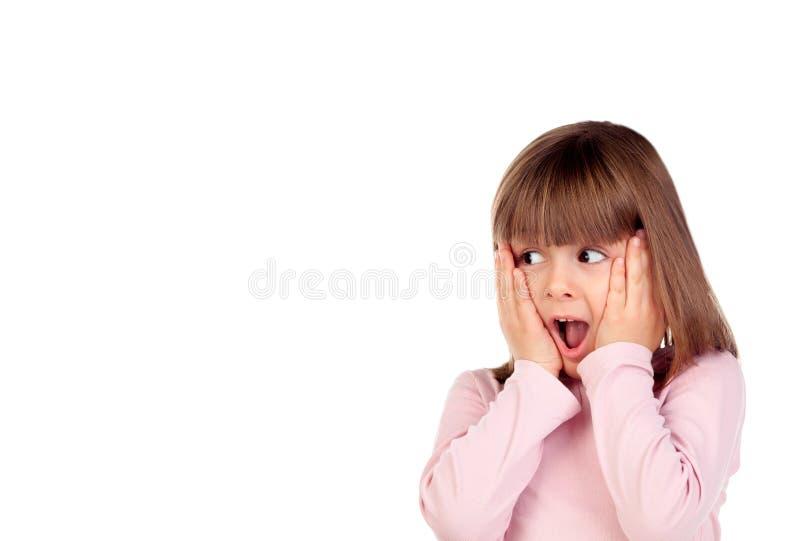 Petite fille étonnée faisant des gestes photographie stock