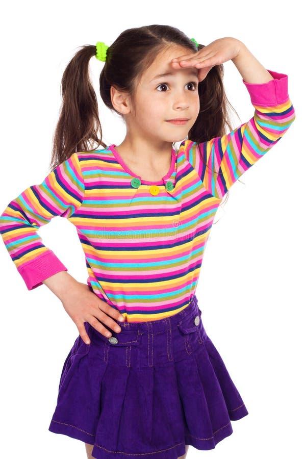 Petite fille étonnée regardant loin photos libres de droits
