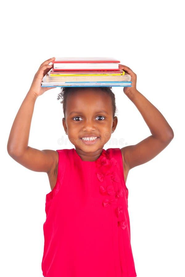 Petite fille africaine adorable avec le livre photos libres de droits