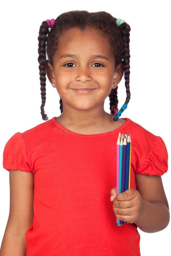 Petite fille africaine avec des crayons image libre de droits