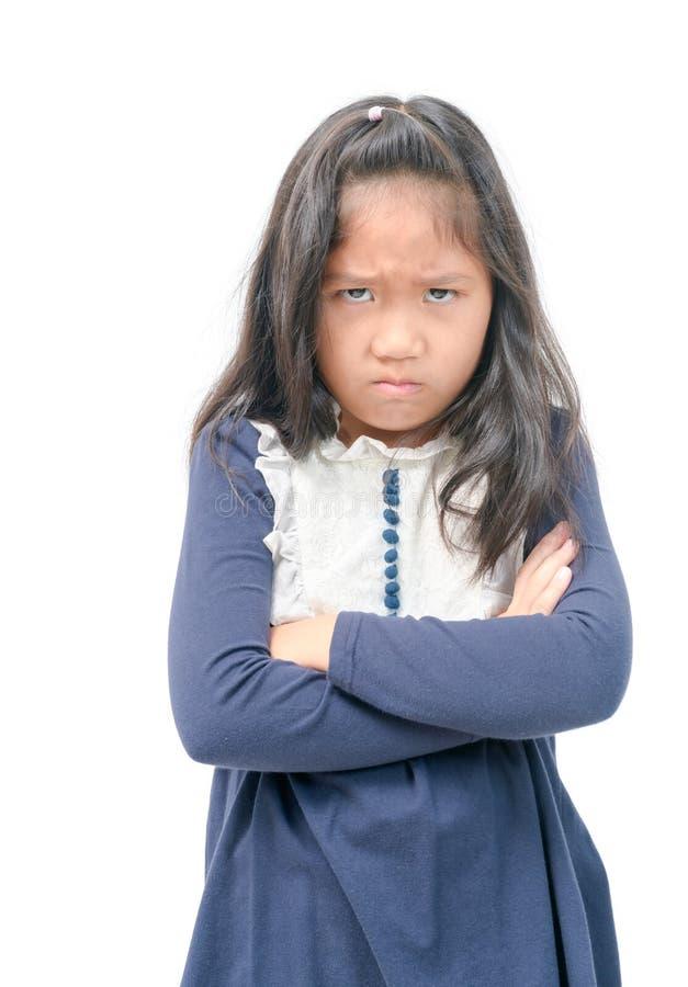 Petite fille asiatique fâchée avec la robe bleue d'isolement images libres de droits
