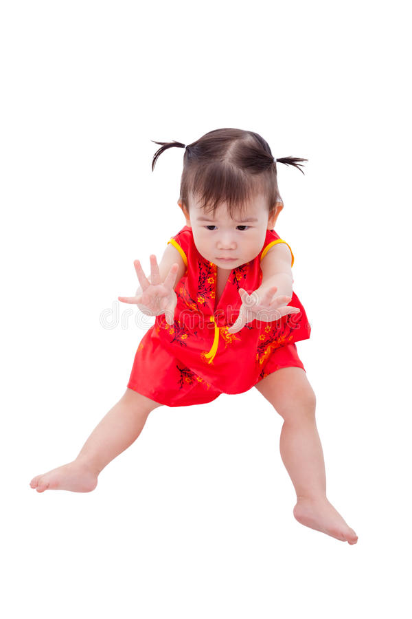 Petite fille asiatique (thaïlandaise) dans le cheongsam de chinois traditionnel images stock