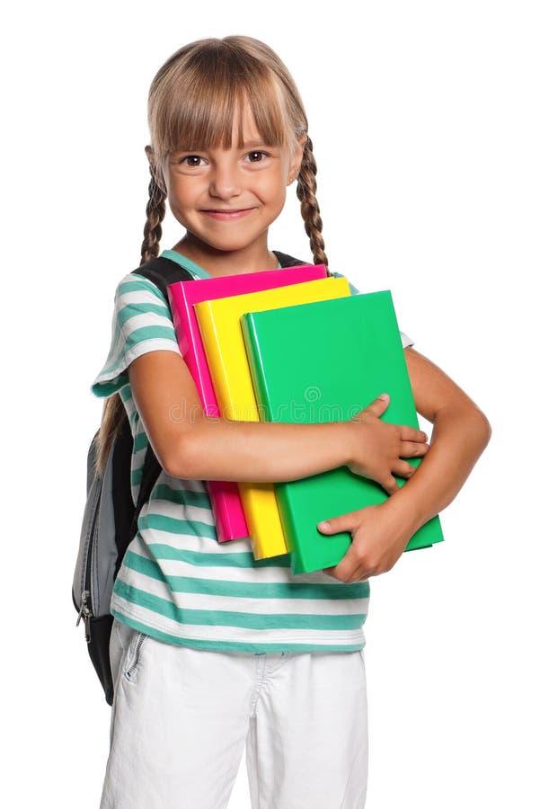 Petite fille avec des livres images libres de droits