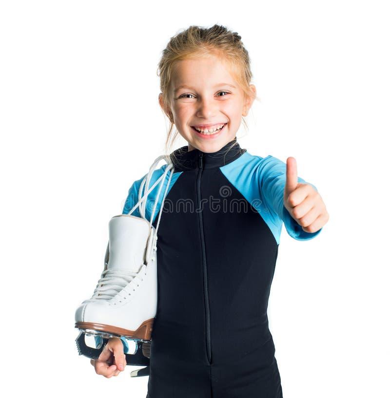 Petite fille avec des patins photo stock
