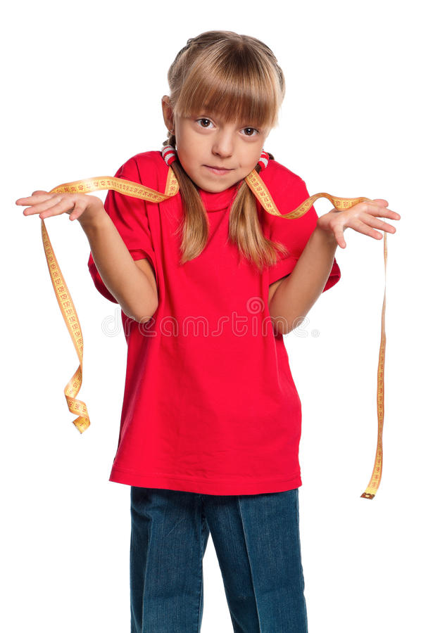 Petite fille avec la bande de mesure images stock