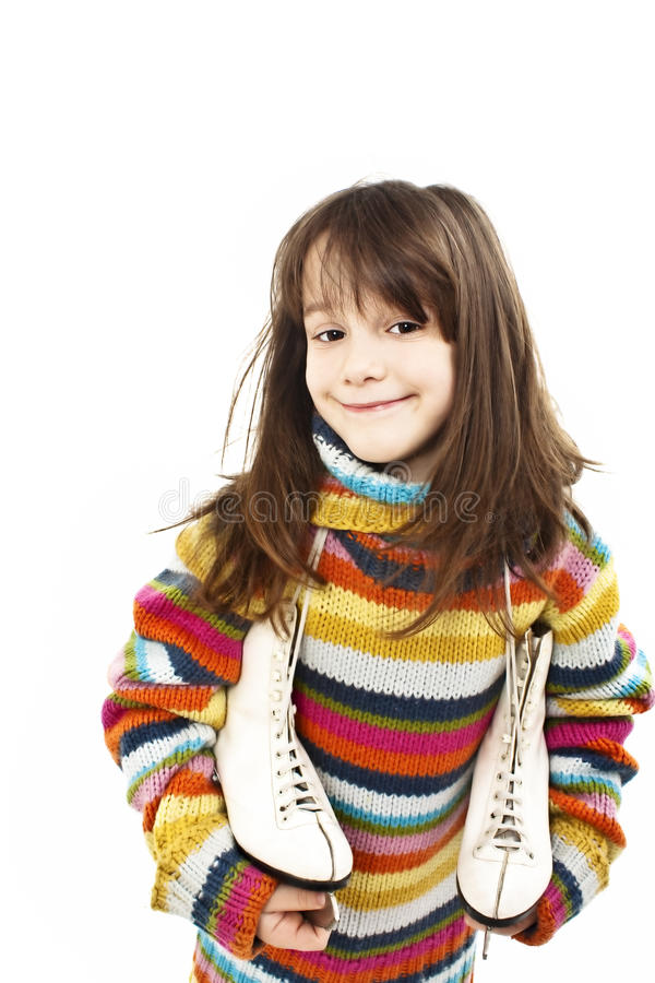 Petite fille avec la figure patins photos stock