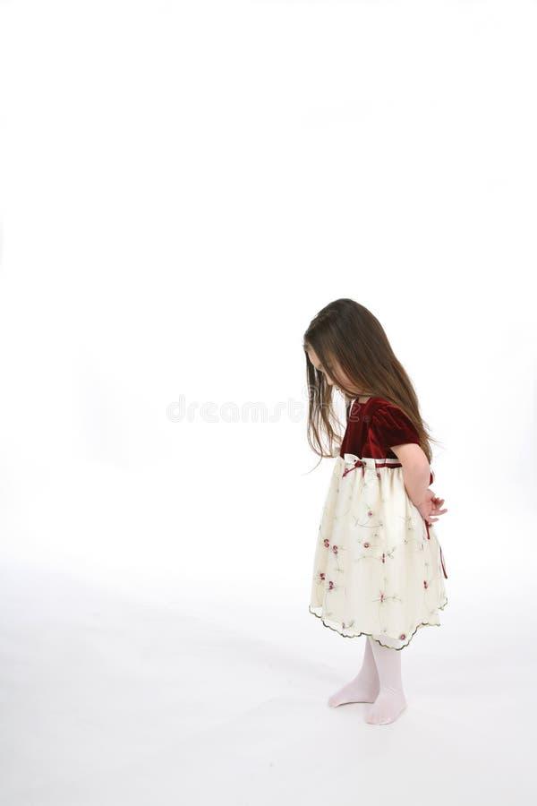Petite fille avec la tête vers le bas photographie stock libre de droits