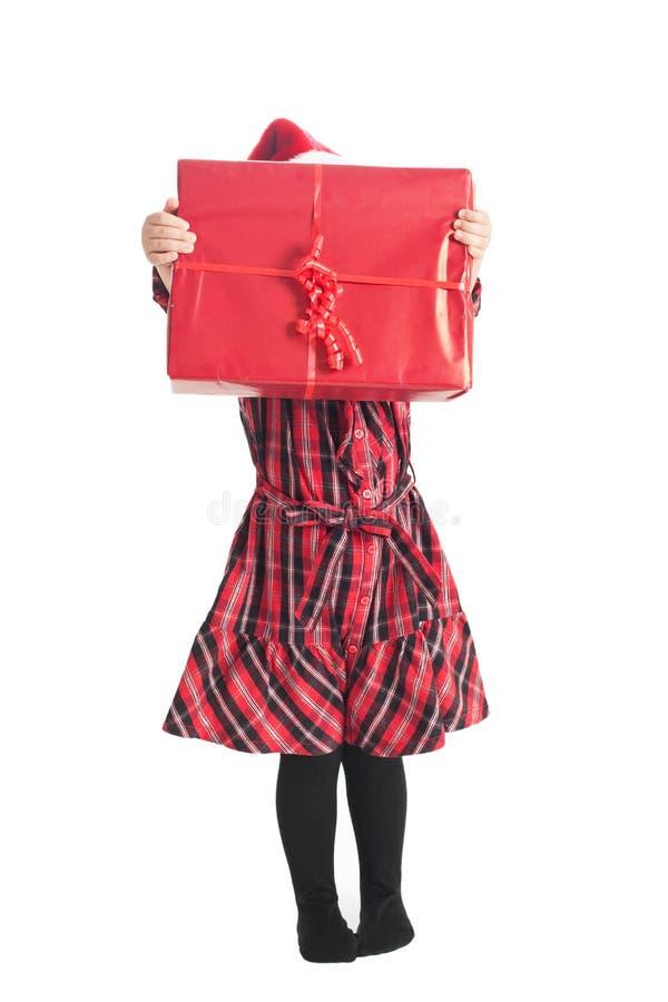 Petite fille avec le cadeau de Noël images libres de droits