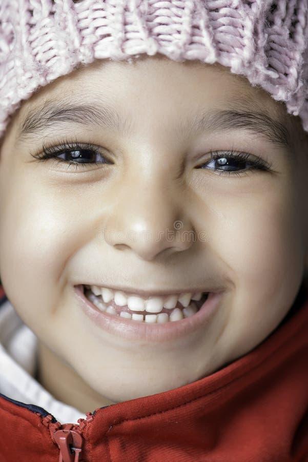 Petite fille avec le grand sourire photographie stock