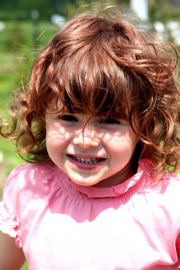 Petite fille avec le grand sourire images libres de droits