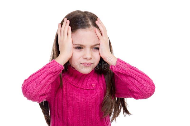 Petite fille avec le mal de tête image stock